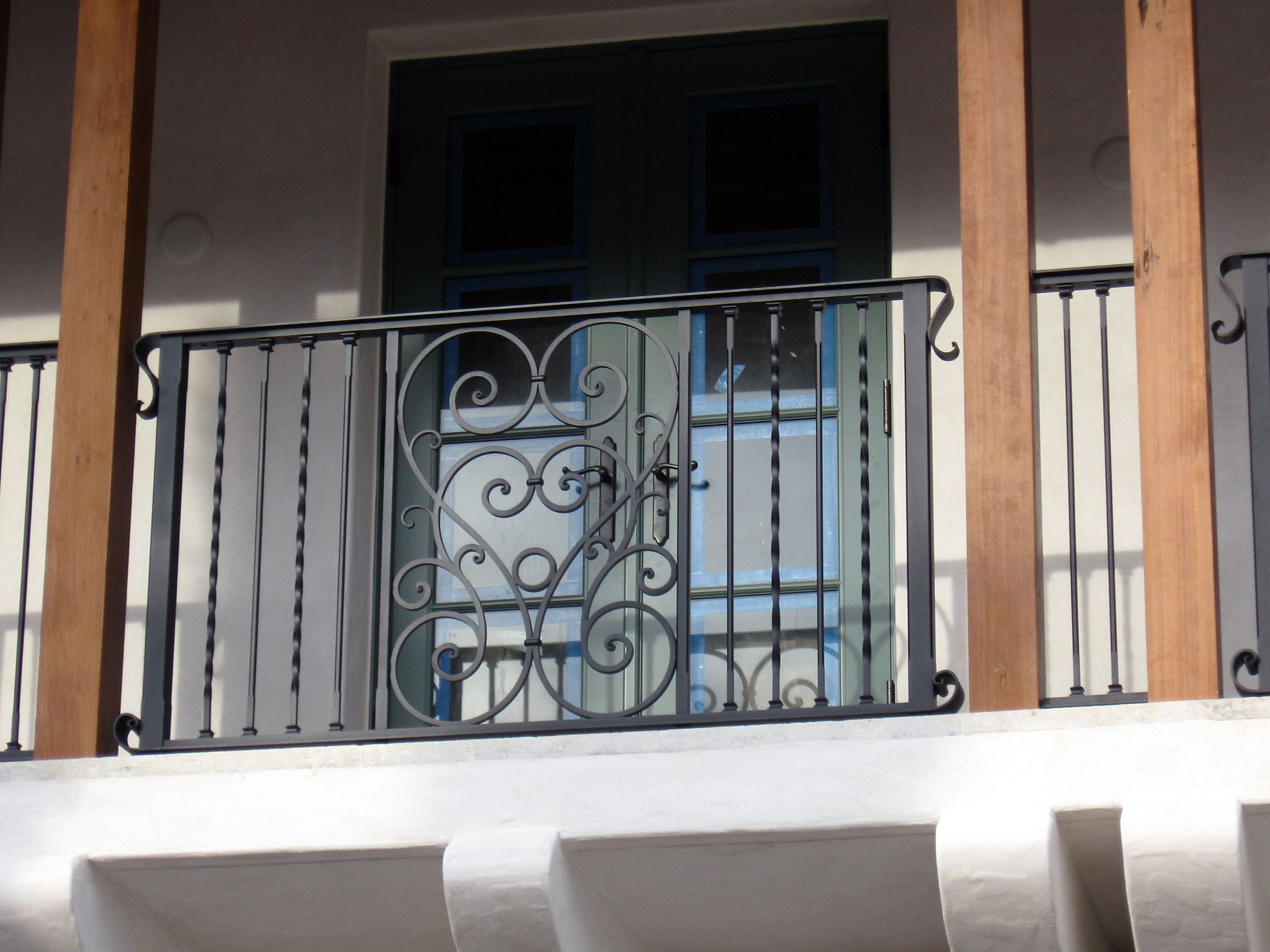 photo of an iron balcony railing