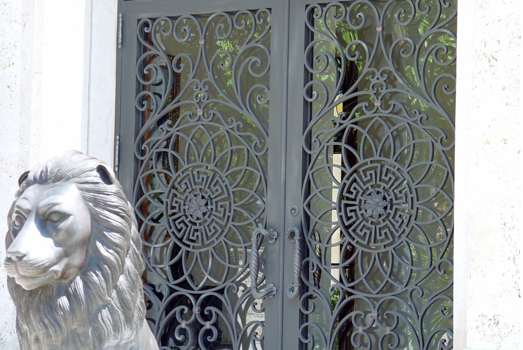 cropped photo of an iron residential door
