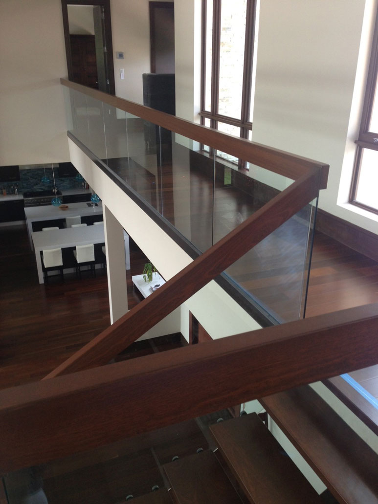 photo of a modern wooden and glass staircase