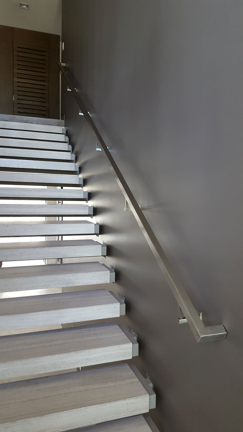photo of a modern metal floating staircase